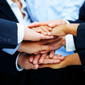 Multi-ethnic pile of hands
