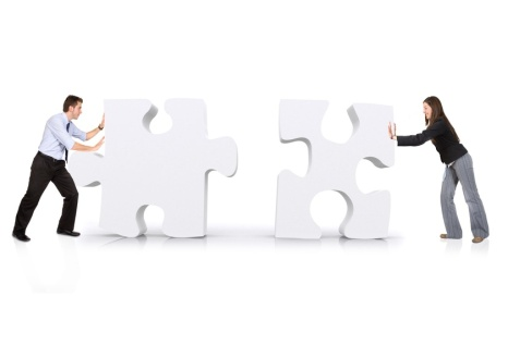 business partners putting puzzle together